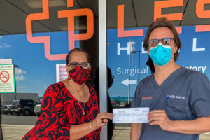 Dr Jan Tawakol presents donation to Clema Lewis